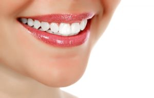 Woman smiling with her strong teeth