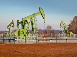 Oil Pump Jack Drilling the Ground