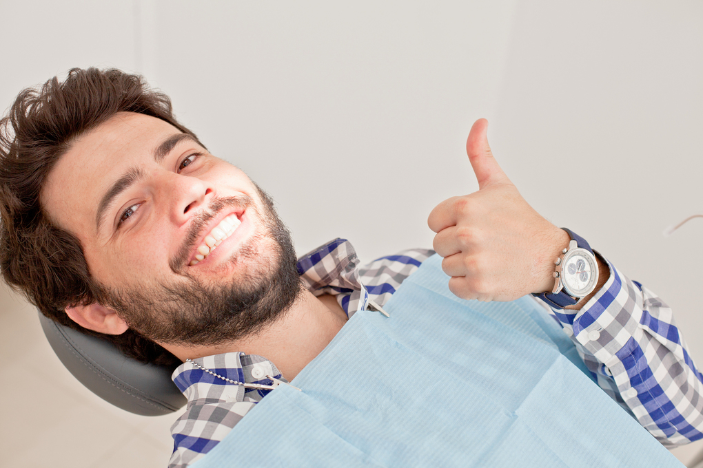 A Delighted Patient in a Dental Clinic
