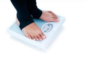 Female standing on a weighing scale