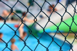 Fence and the kids in the pool