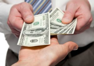 Man handing salary