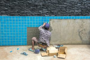 Man renovating a swimming pool