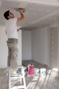 Man plastering the ceiling