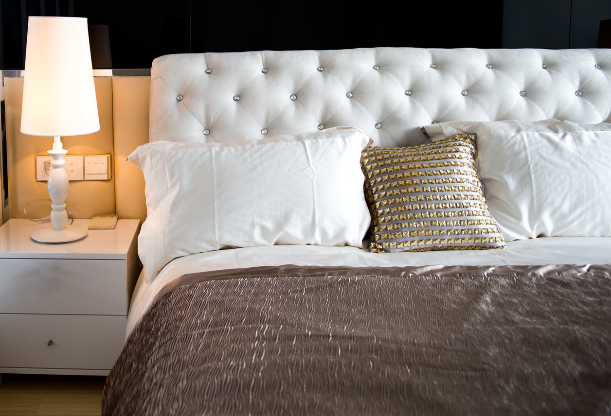 King-sized bed and a bed-side table