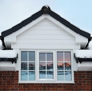 Double Glazing for Winter with Snow and icicles plus beautiful Sunset reflection from adjacent hills with room for text above