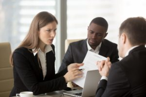 Businessman and woman interviewing a lawyer