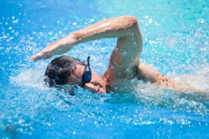 Man swimming in his pool