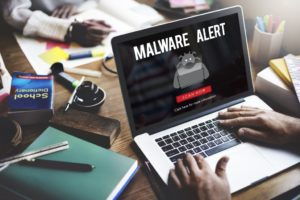 malware alert seen flashing on a laptop screen