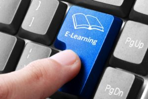 Closeup of blue e-learning button on the keyboard