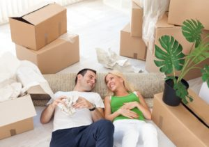couple lying down in middle of boxes