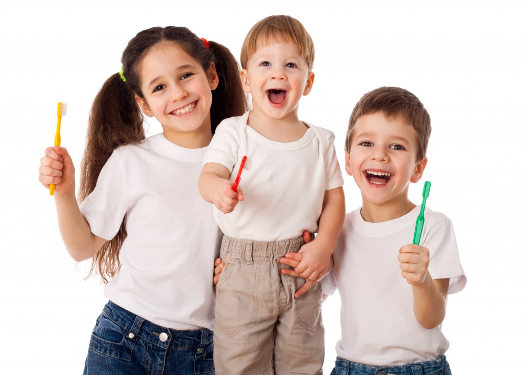 kids holding toothbrushes