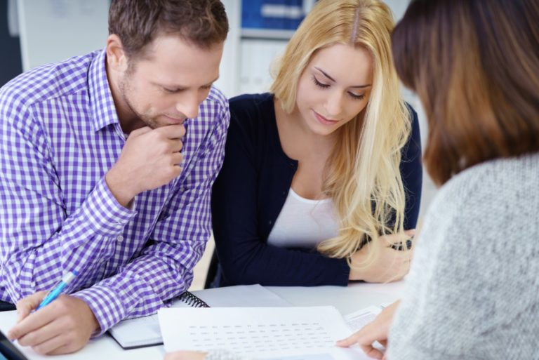 Couple meeting a broker about property investment