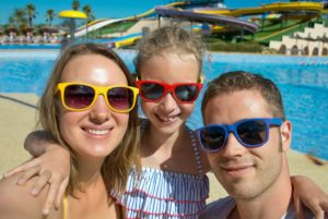 Parents and child wearing sunglasses
