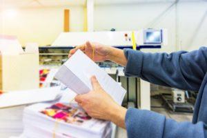 man printing flyers
