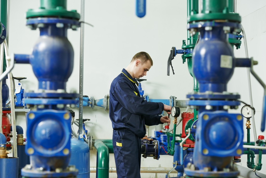 A man inspecting pumps