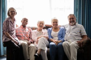a group of old people sitting on a couch