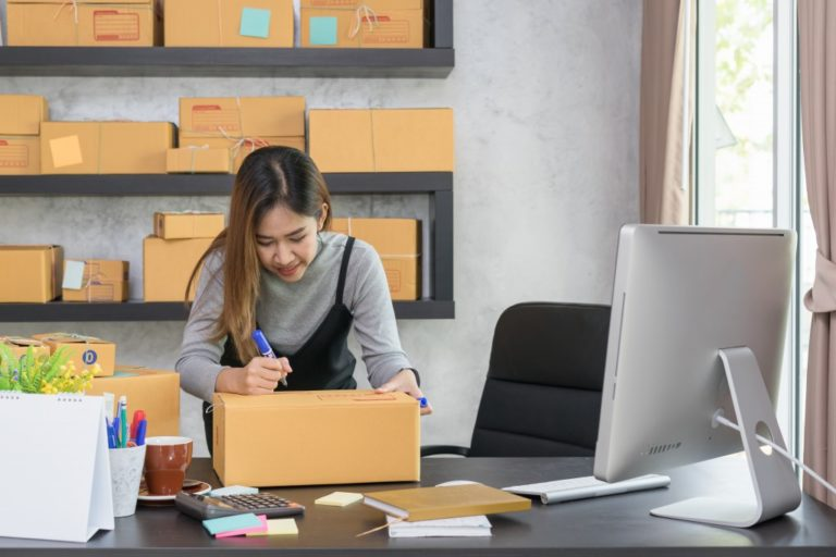 Business owner packing a package