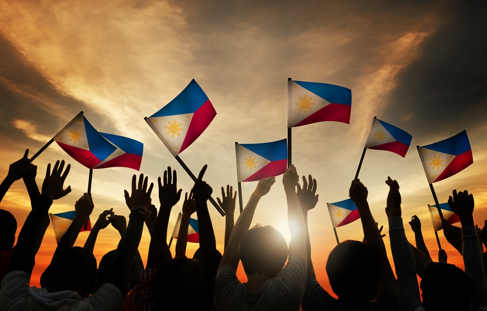 People waving the Philippine flag
