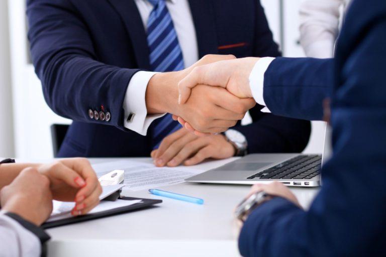 Businessmen shaking hands after negotiation