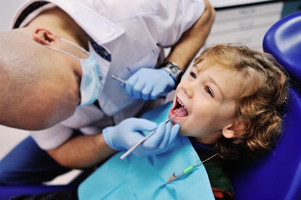 a kid at the dentist