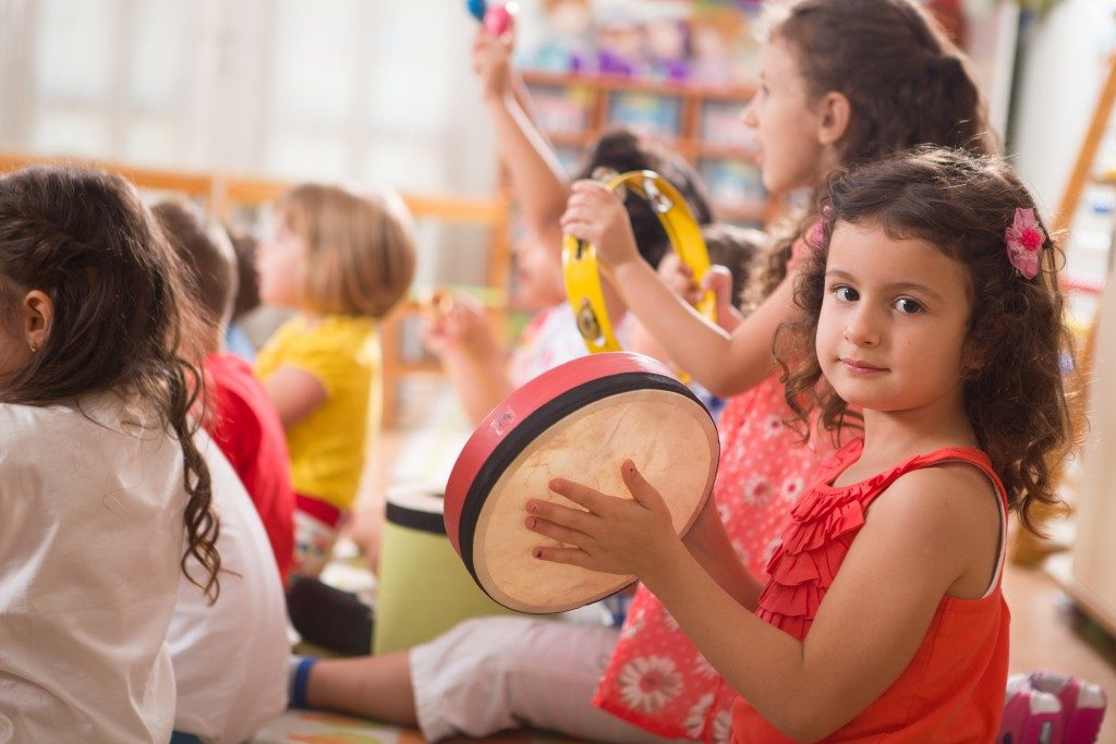 Kids playing instrument during music class