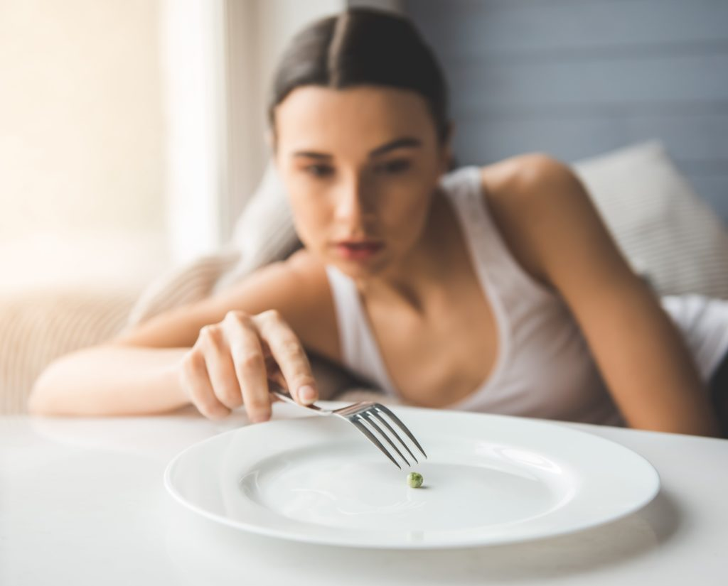 woman suffering from eating disorder