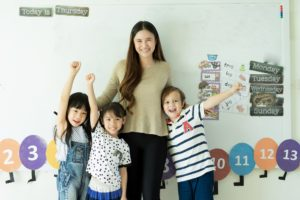 Preschool teacher with students