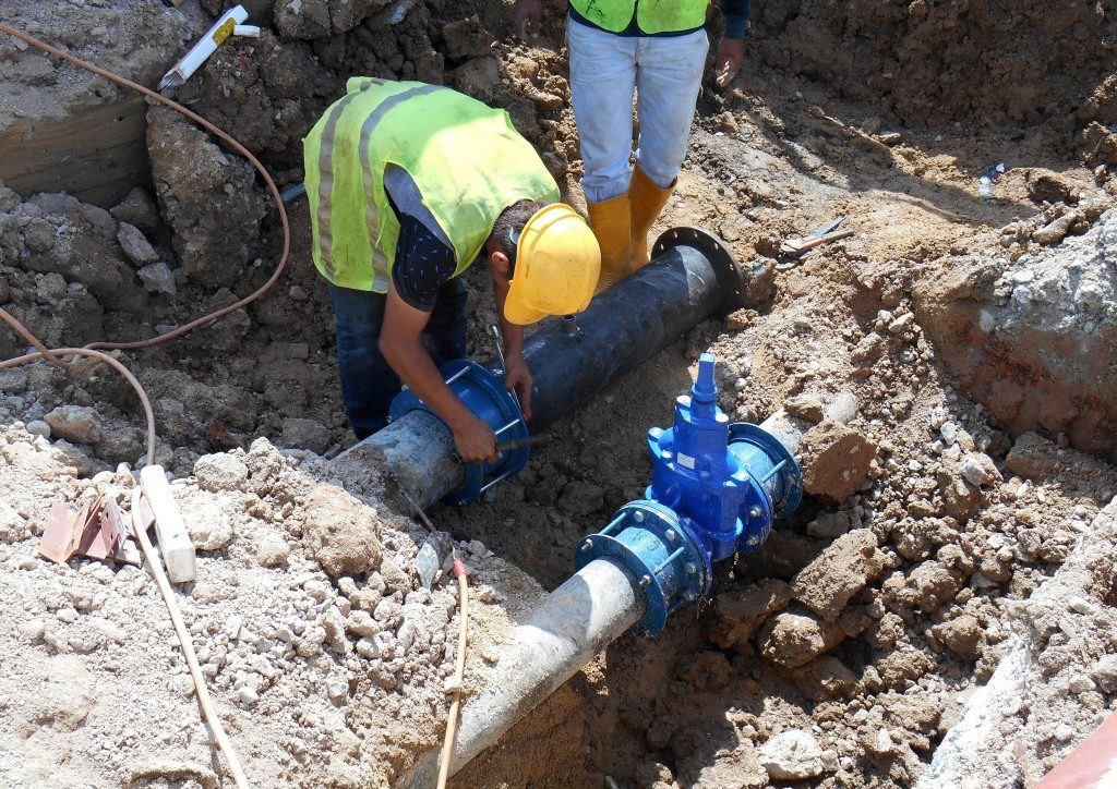 Man fixing sewage line