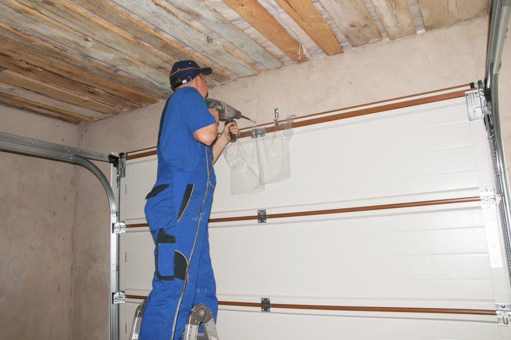 Repairman fixing a garage door
