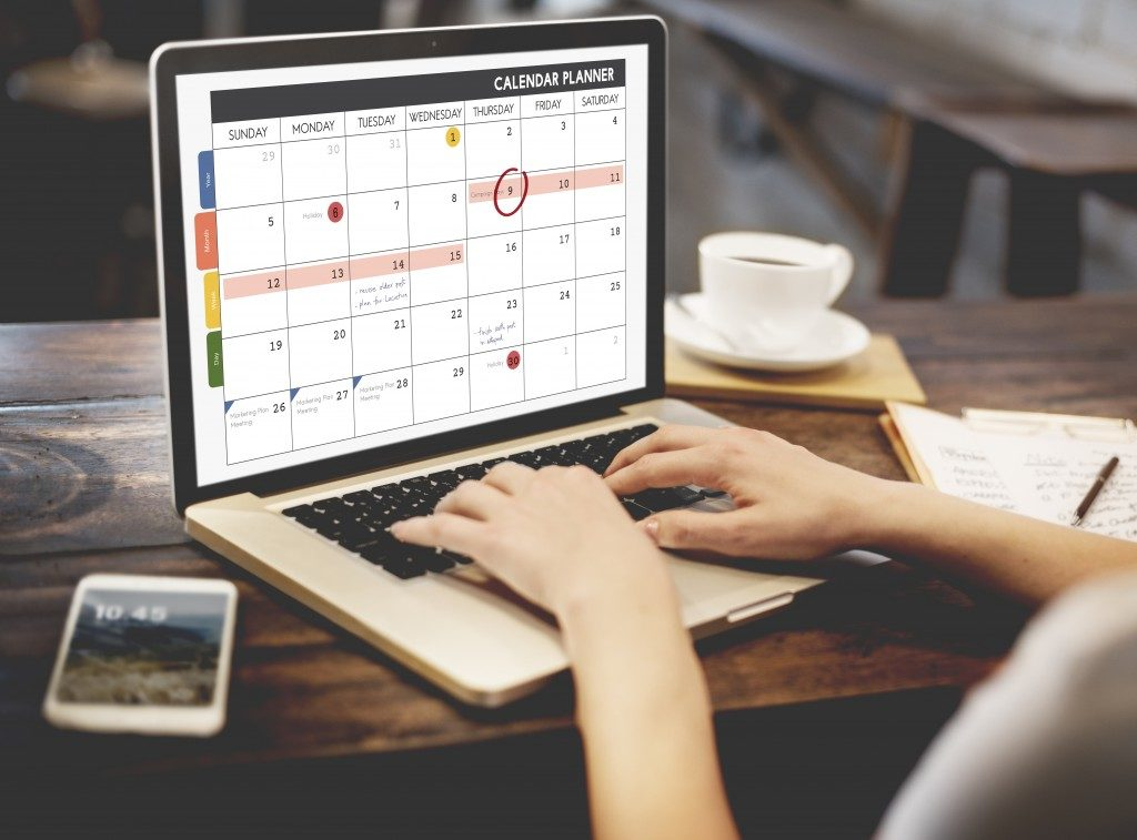 Woman on her laptop with calendar