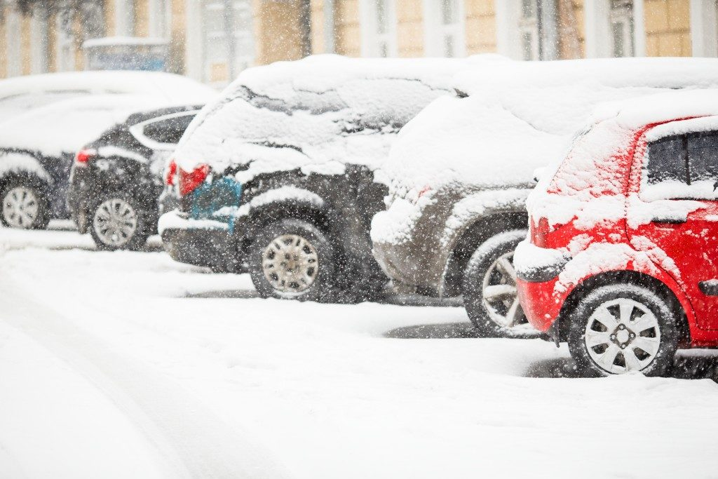 Cars covered with fresh white snow