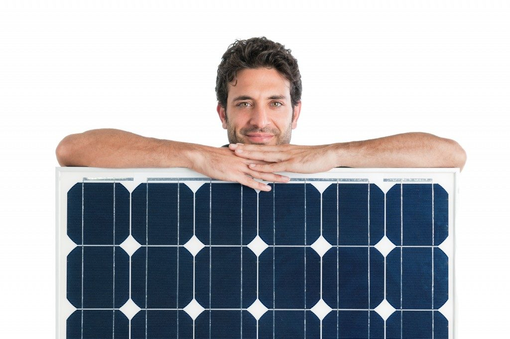 Man with mini solar panels