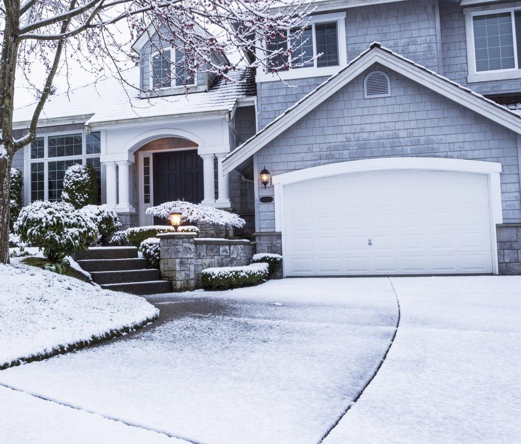 Suburban home covered with snow
