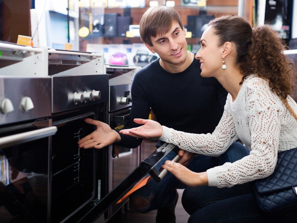 Couple looking at kitchen stove