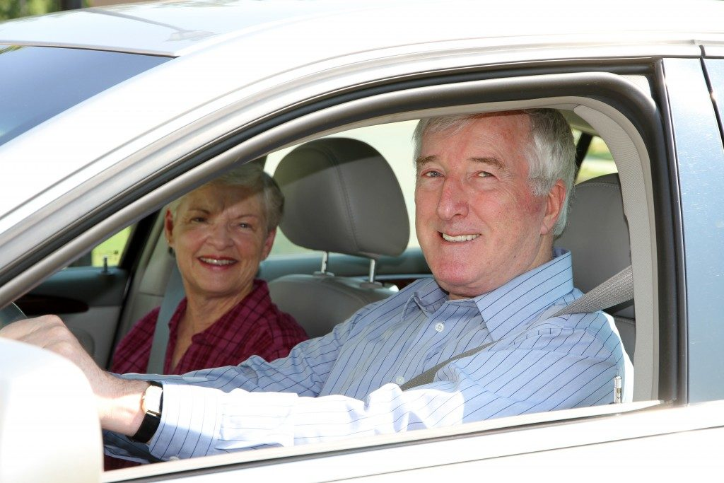 Senior citizen couple in a car