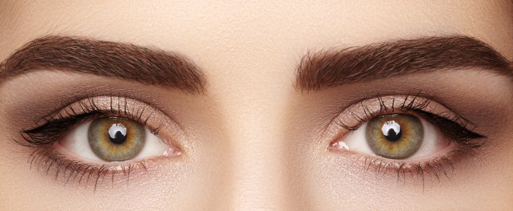 close up photo of woman's eyes with long lashes and eyebrows