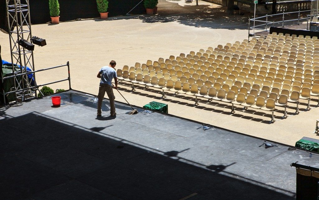 Preparing the stage for an event