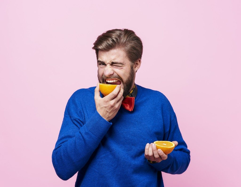 man eating fruits