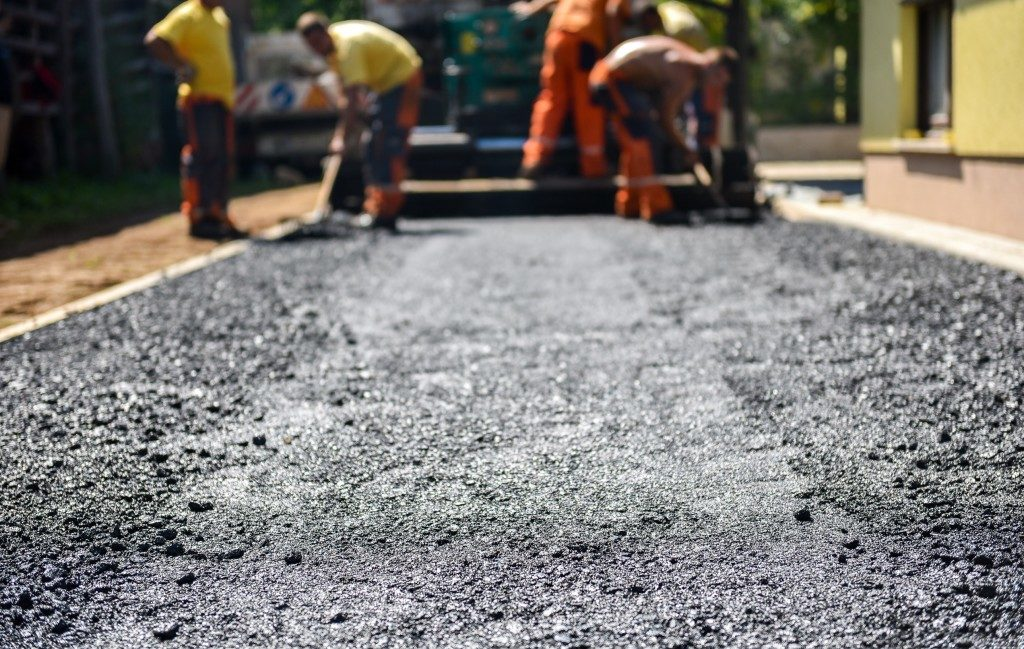 The top layer of asphalt road on a private residence house driveway