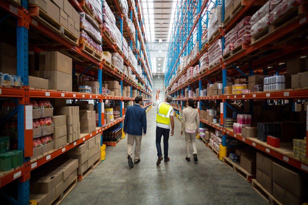 people walking inside a warehouse