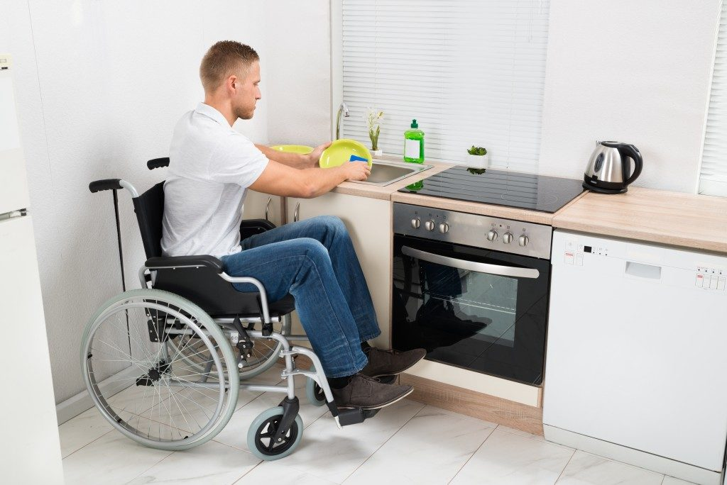 disabled man washing the dishes