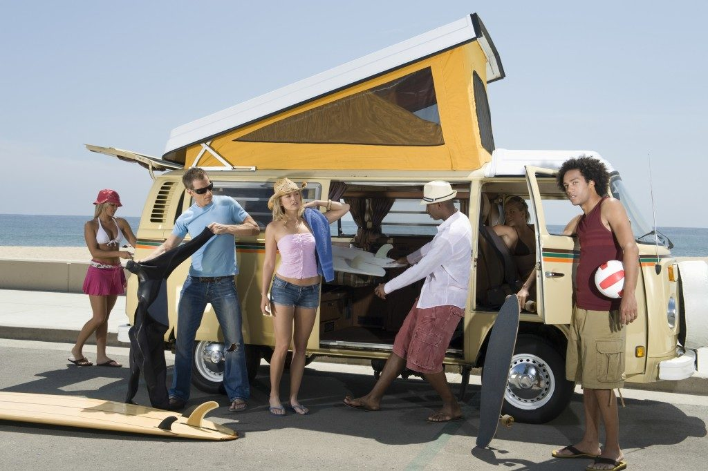 group of young people by the campervan