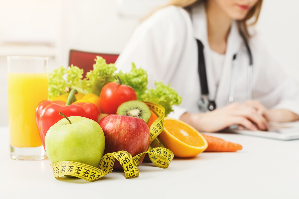 nutritionist with fruits and veggies