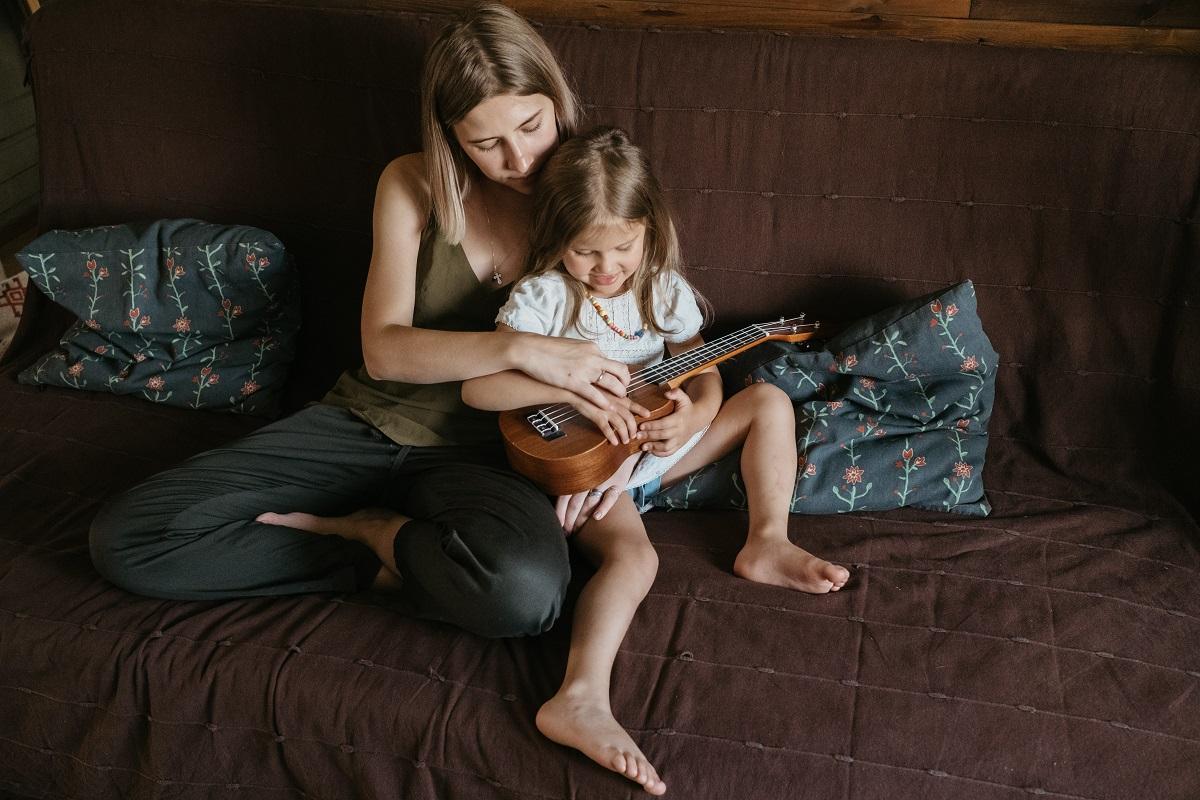 mother and child playing ukelele