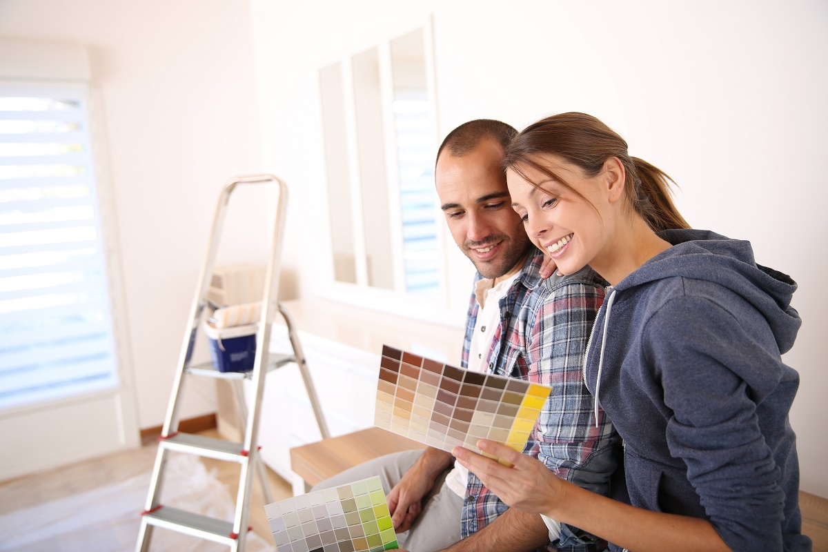 couple choosing colors for walls