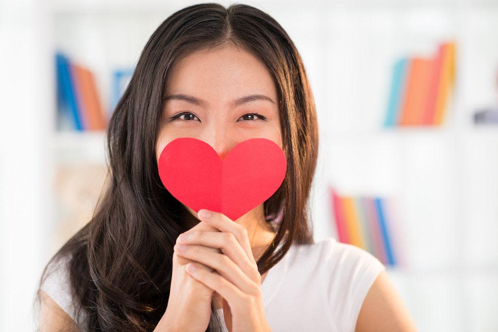 holding a heart cutout