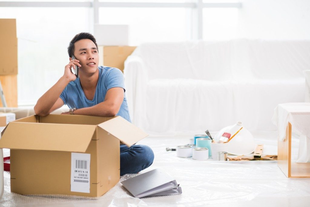 man packing things for move