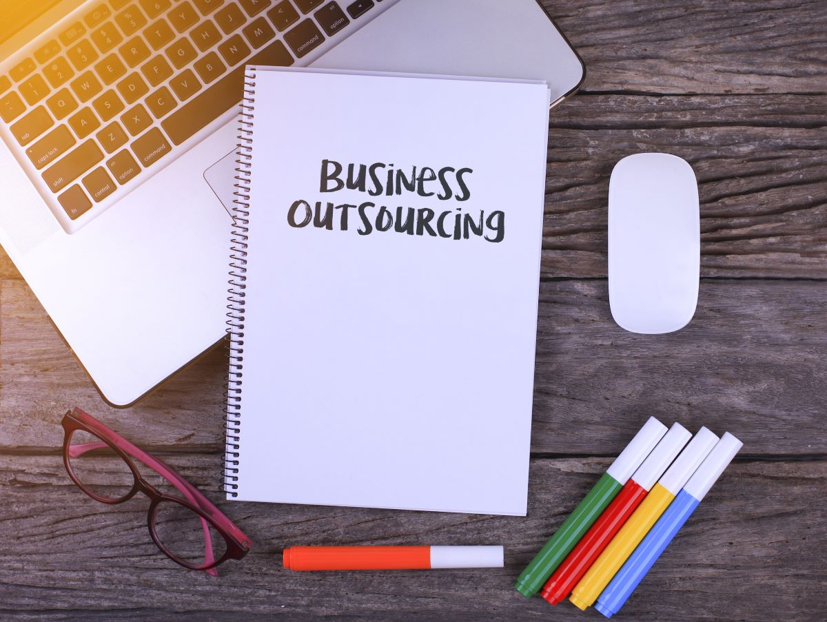 business outsourcing written on notebook