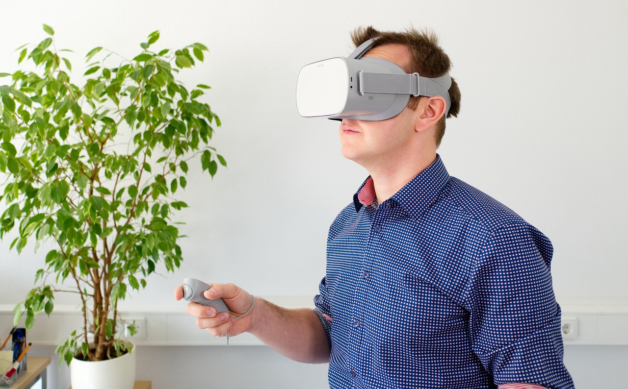 man playing virtual reality game